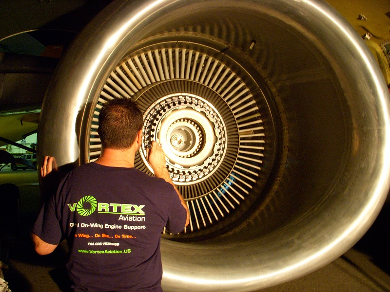 man fixing airplane engine